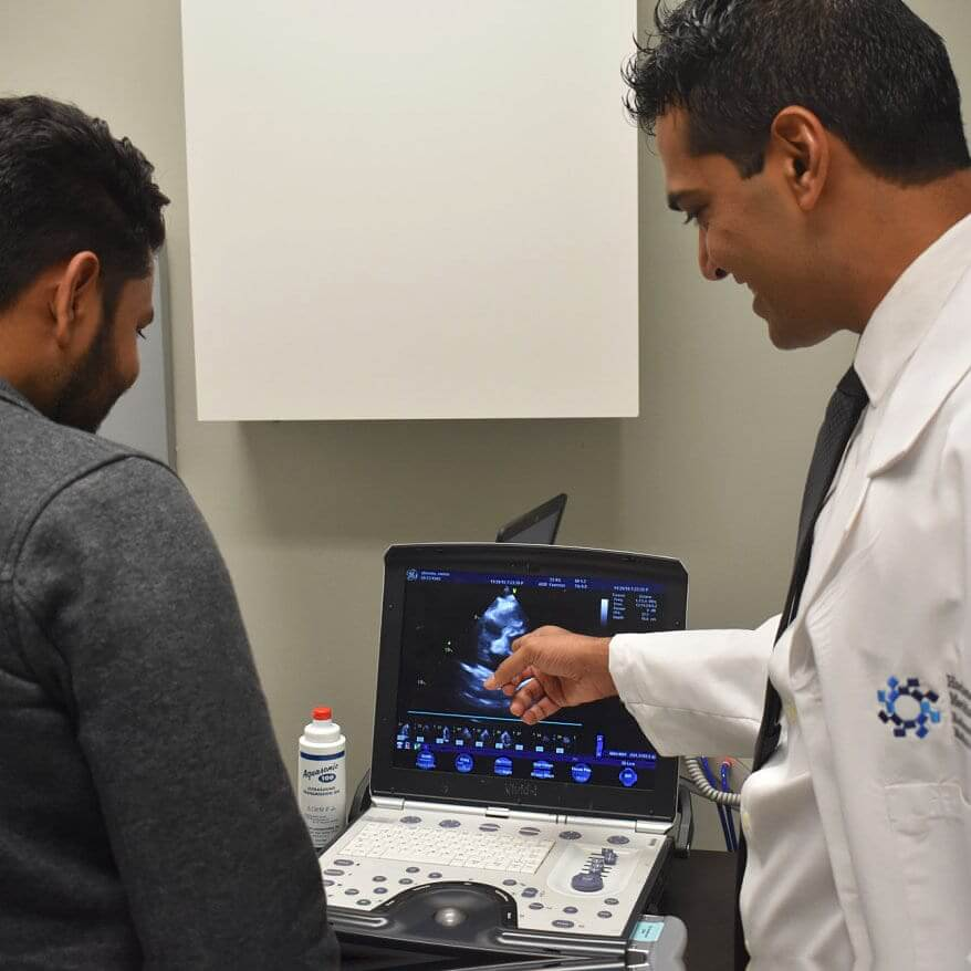 doctor showing ultrasound to the man