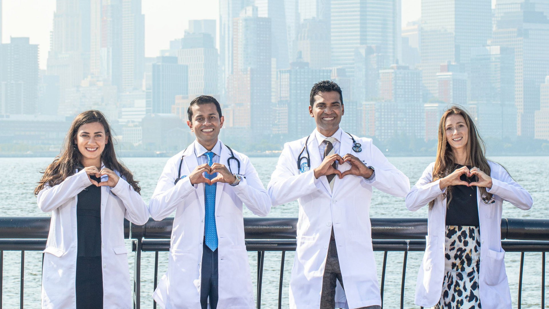 doctors smiling forming heart