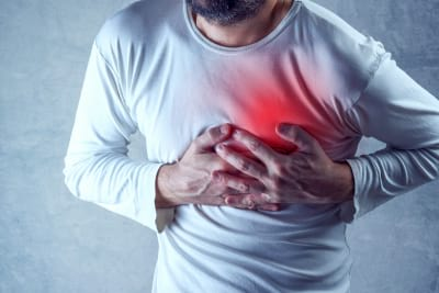 Severe heartache man suffering from chest pain