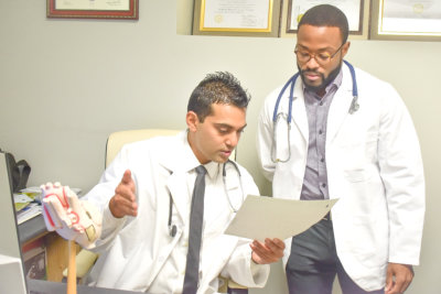 Dr. Shah talking with someone